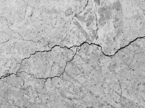 krakingowy-betonowy-tekstury-zblizenia-tlo