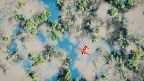 antena-czerwony-samolot-latajacy-nad-lasem-z-jeziorami-i-chmurami